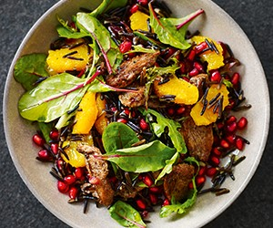 Recipe: Wok-fried five-spiced duck breast with orange and pomegranate wild rice salad